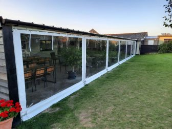clear window walls attached to a restaurant